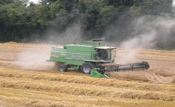 combine harvester in action during arable and tillage tours from agritours ireland.